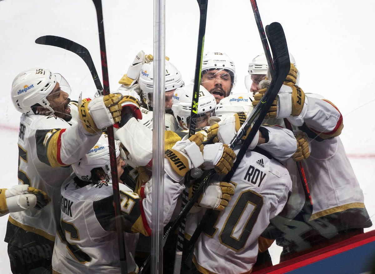 Vegas Golden Knights' Nicolas Roy (10) celebrates his game-winning goal against the Montreal Ca ...