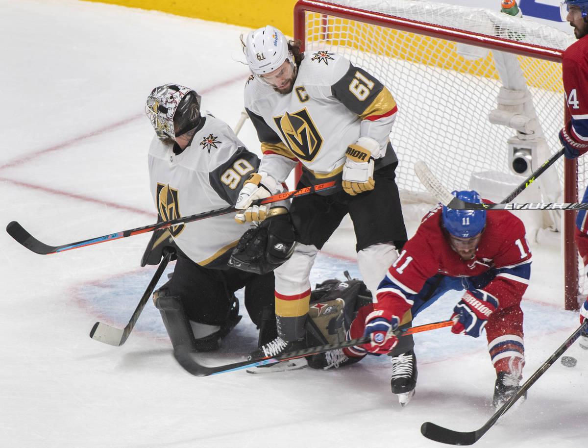 Vegas Golden Knights goaltender Robin Lehner looks on as Knights' Mark Stone (61) and Mo ...
