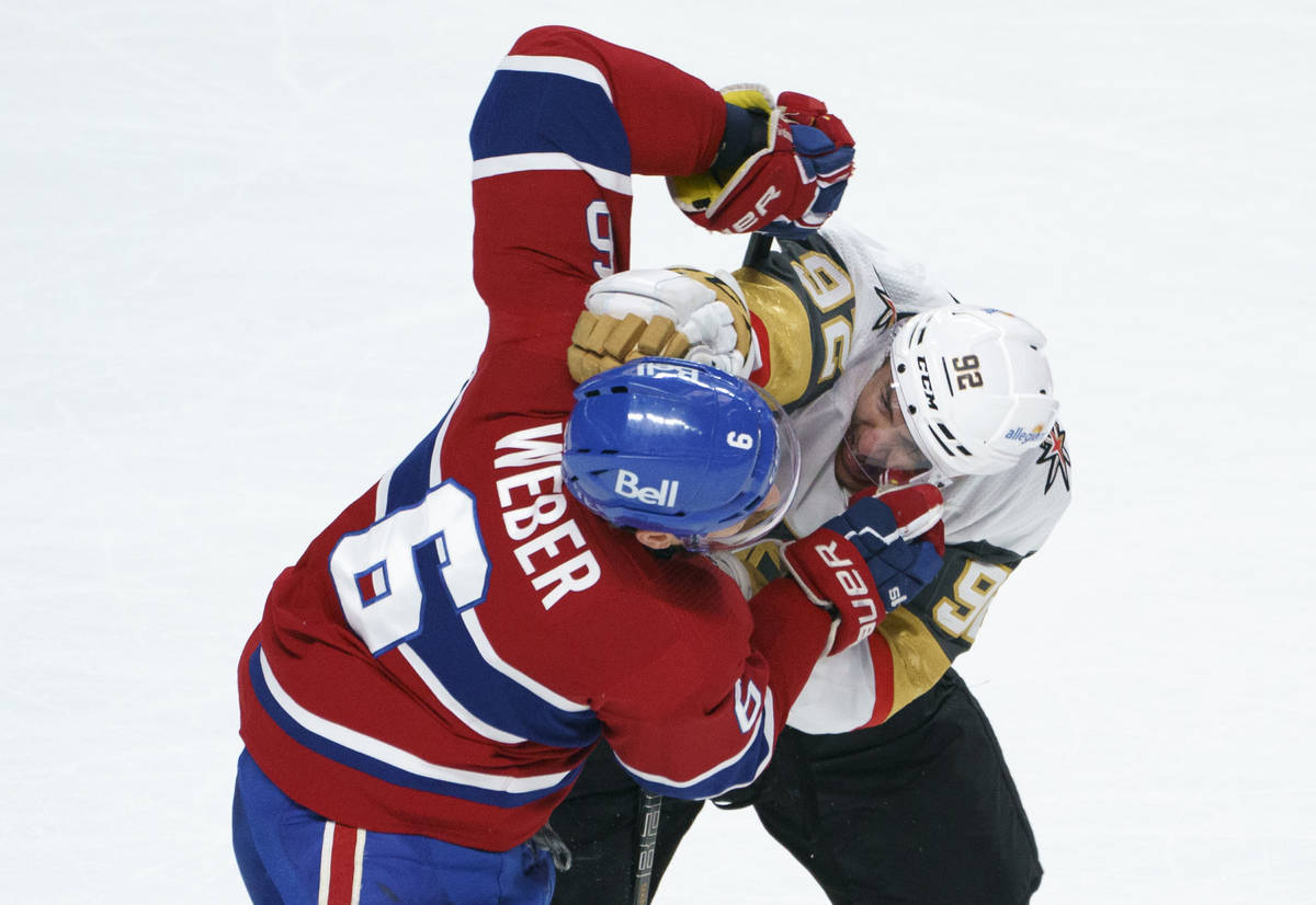 Montreal Canadiens' Shea Weber and Vegas Golden Knights' Tomas Nosek (92) fight during the seco ...