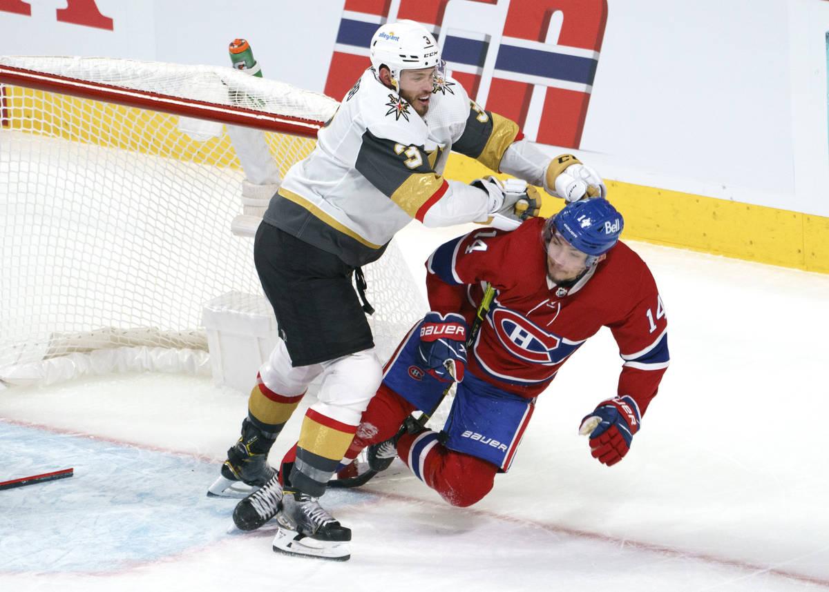 Montreal Canadiens' Nick Suzuki is taken out by Vegas Golden Knights' Brayden McNabb (3) during ...