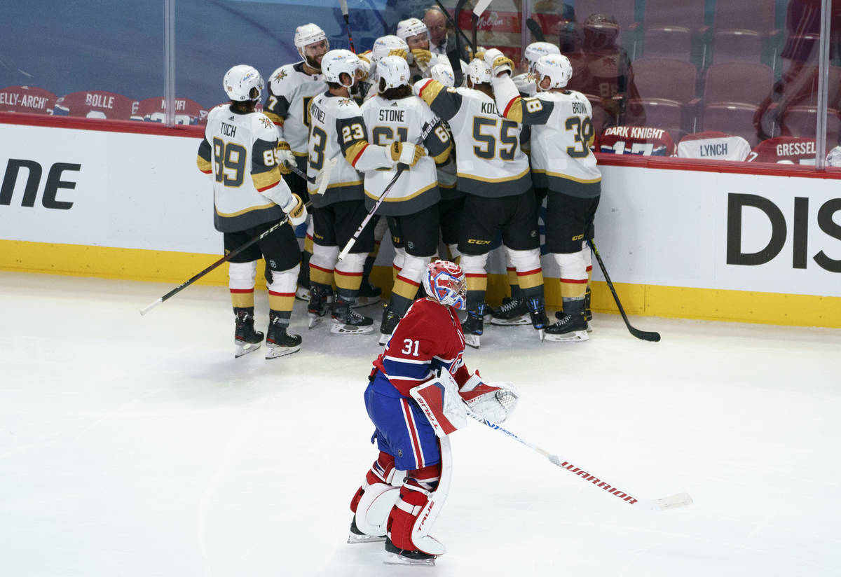 Montreal Canadiens goaltender Carey Price skates off the ice as members of the Vegas Golden Kni ...