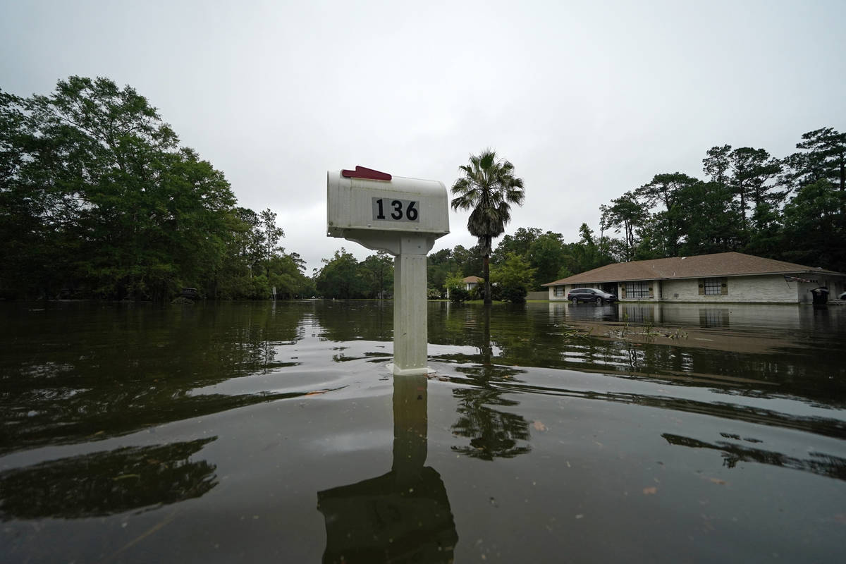 A flooded neighborhood is seen after Tropical Storm Claudette passed through in Slidell, La., S ...