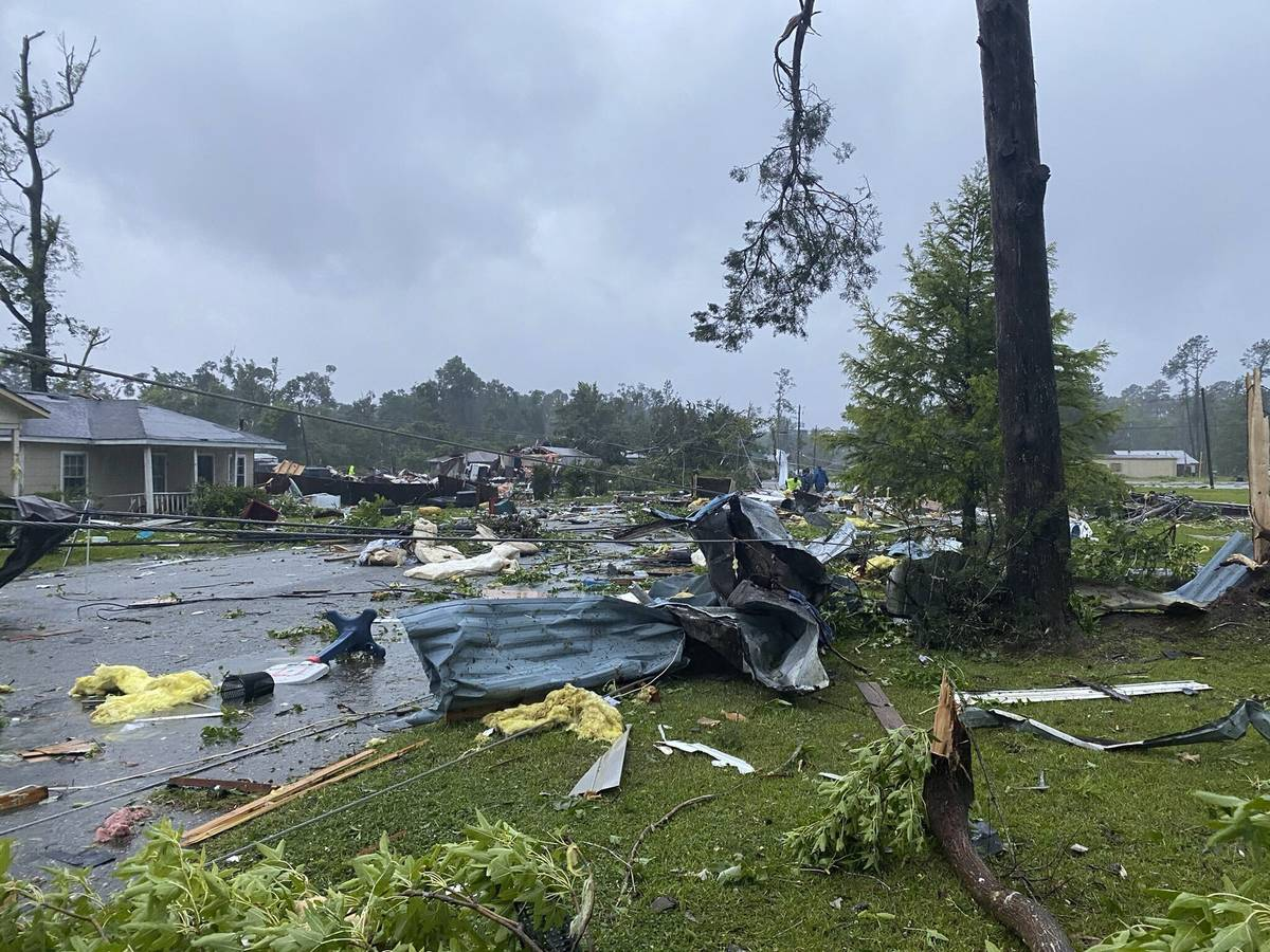 This photo provided by Alicia Jossey shows debris covering the street in East Brewton, Ala., on ...