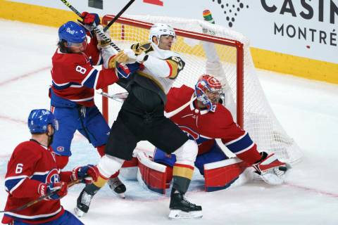 Vegas Golden Knights' Max Pacioretty is taken out by Montreal Canadiens defenseman Ben Chiarot ...