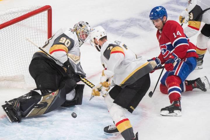 Montreal Canadiens' Nick Suzuki (14) moves in on Vegas Golden Knights goaltender Robin Lehner a ...