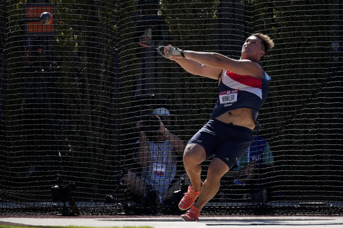 Rudy Winkler sets an American record during the finals of the men's hammer throw event at the U ...