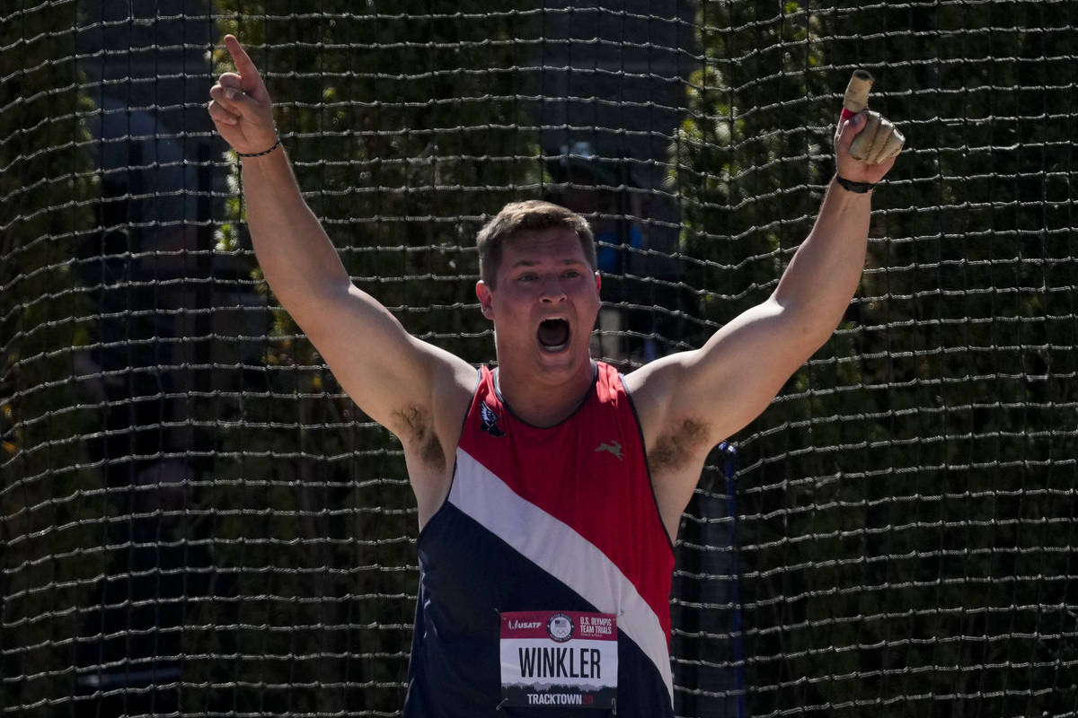 Rudy Winkler reacts after setting an American record during the finals of the men's hammer thro ...