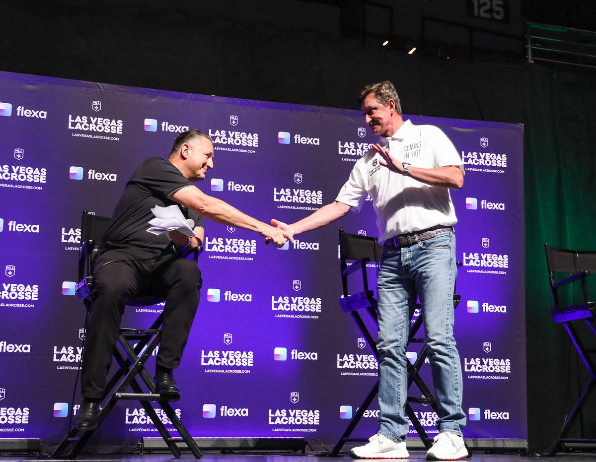 Nick Sakiewicz, commissioner of the National Lacrosse League, left, shakes hands with Wayne Gre ...