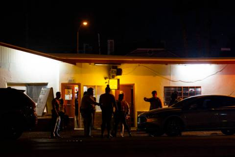 Las Vegas police investigate the scene of a homicide on Boulder Highway north of Russell Road i ...