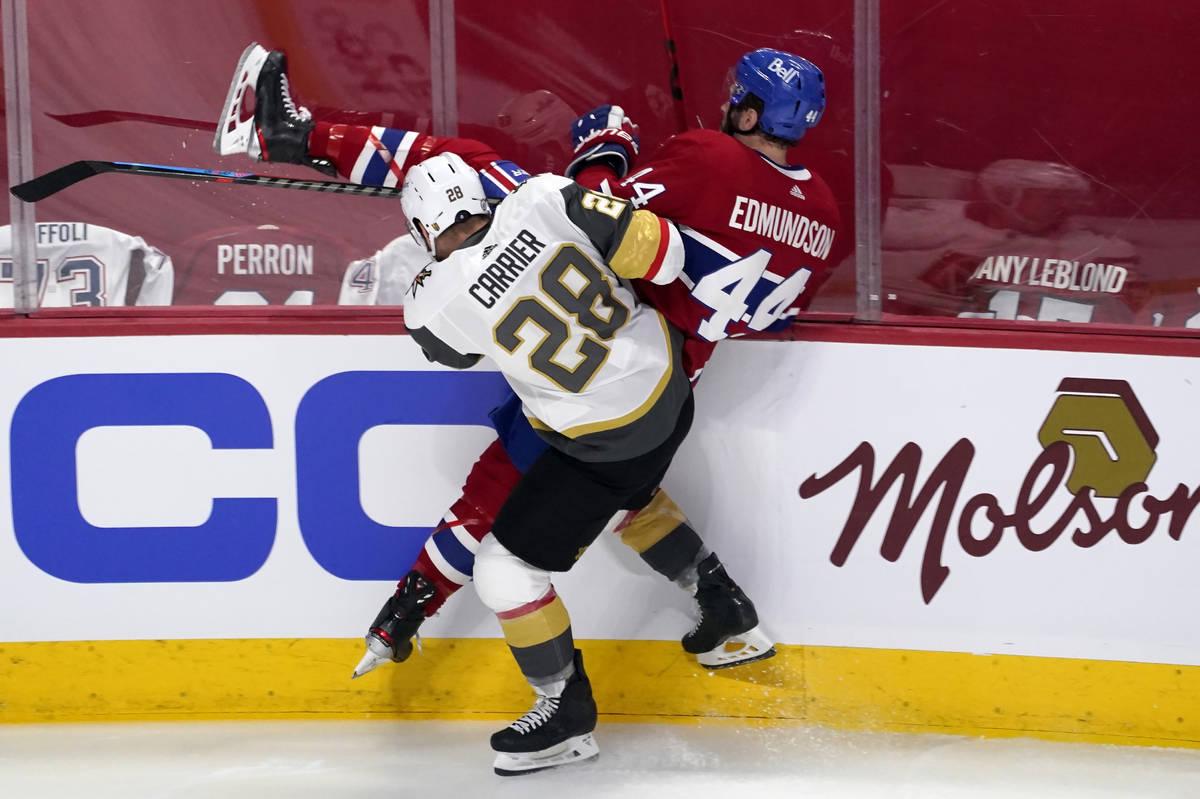 Vegas Golden Knights' William Carrier (28) checks Montreal Canadiens' Joel Edmundson (44) durin ...