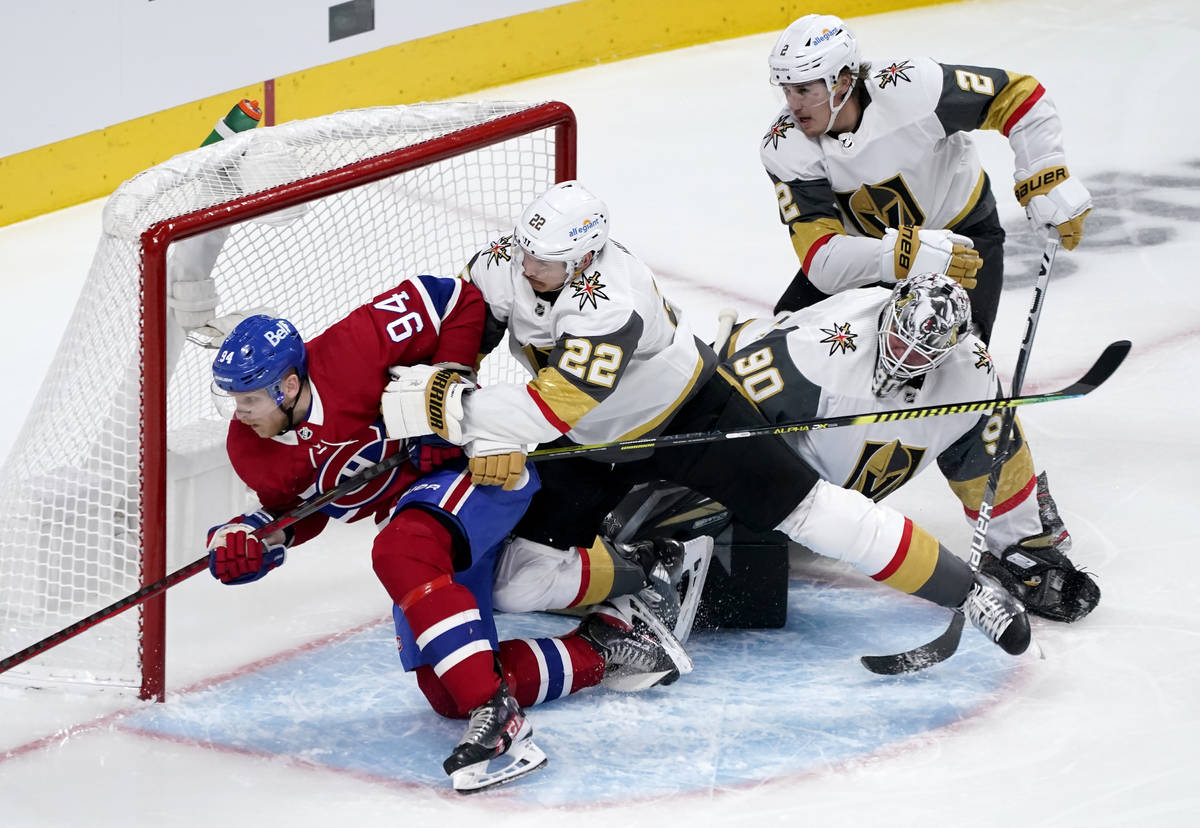 Vegas Golden Knights' Nick Holden (22) tries to clear Montreal Canadiens' Corey Perry (94) from ...