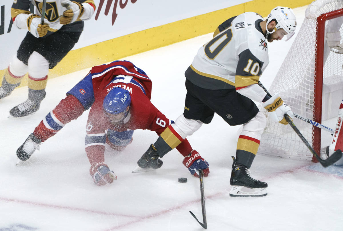 Montreal Canadiens defenseman Shea Weber (6) tries to clear the puck away from Vegas Golden Kni ...