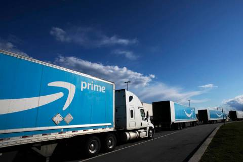This April 21, 2020 file photo shows Amazon tractor trailers line up outside the Amazon Fulfill ...