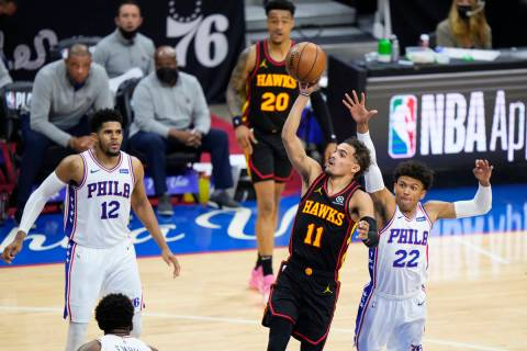 Atlanta Hawks' Trae Young (11) goes up for a shot against Philadelphia 76ers' Matisse Thybulle ...