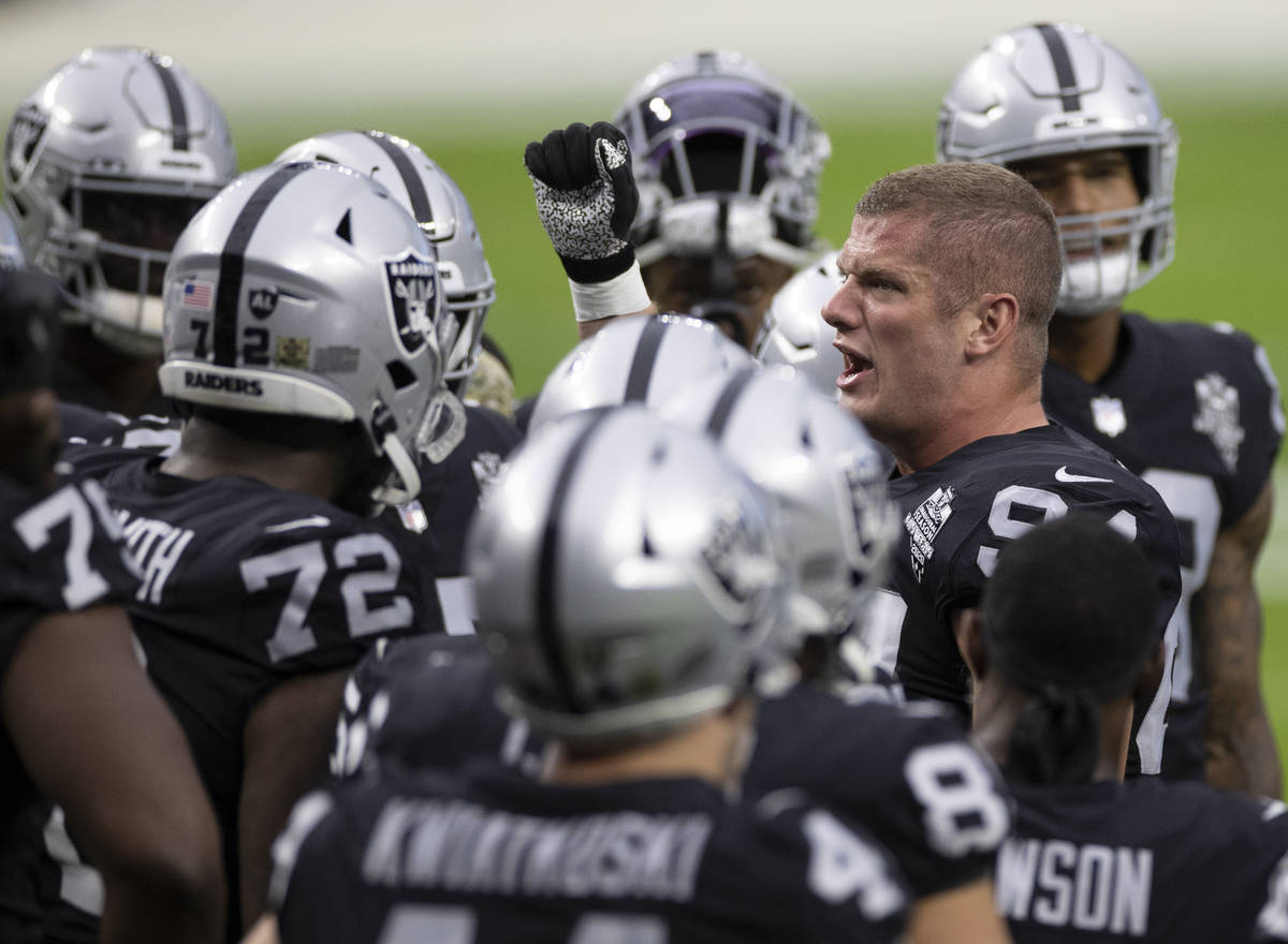 Las Vegas Raiders defensive end Carl Nassib (94) fires up his team before the start of an NFL f ...
