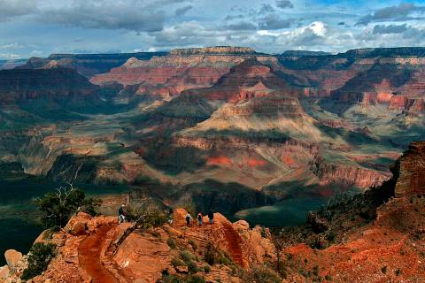 Visitors hike along the South Rim of the Grand Canyon in 2005. (AP Photo/Rick Hossman)