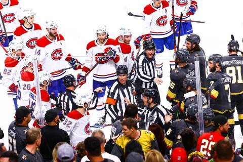 Referees try to keep the Montreal Canadiens from the Golden Knights after the Habs defeated the ...
