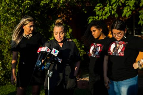 Aracely Palacio, second from left, is comforted by attorney Ofelia Markarian while speaking dur ...