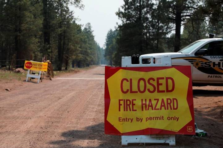 The Coconino County Sheriff's Office blocks off a U.S. Forest Service Road outside of Flagstaff ...