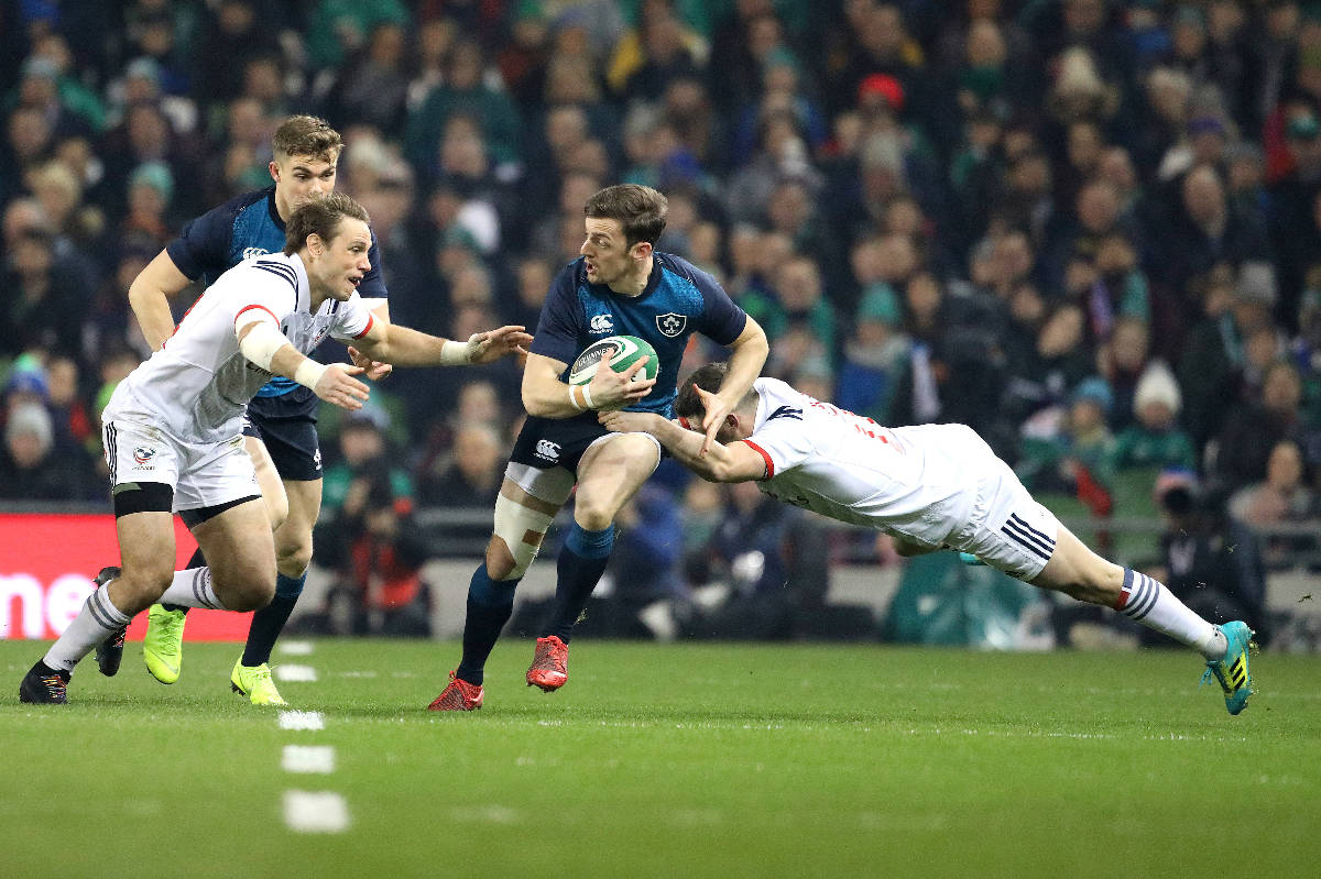 Ireland's Darren Sweetnam, centre, is tackled by USA's Will Magie, right, and Blaine Scully, le ...