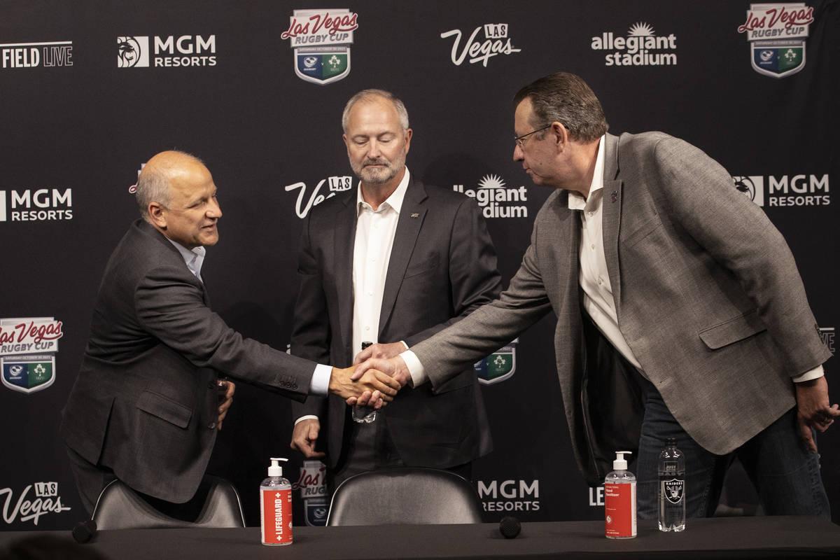 Marc Badain, from left, Las Vegas Raiders president, Steve Hill, CEO and president of Las Vegas ...