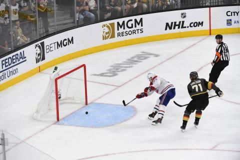 Montreal Canadiens center Nick Suzuki (14) shoots an empty net goal ahead of Vegas Golden Knigh ...