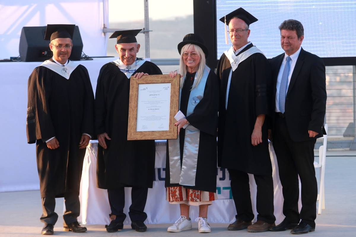 Dr. Miriam Adelson receives her honorary doctorate from Professor Yehuda Shoenfeld, president o ...