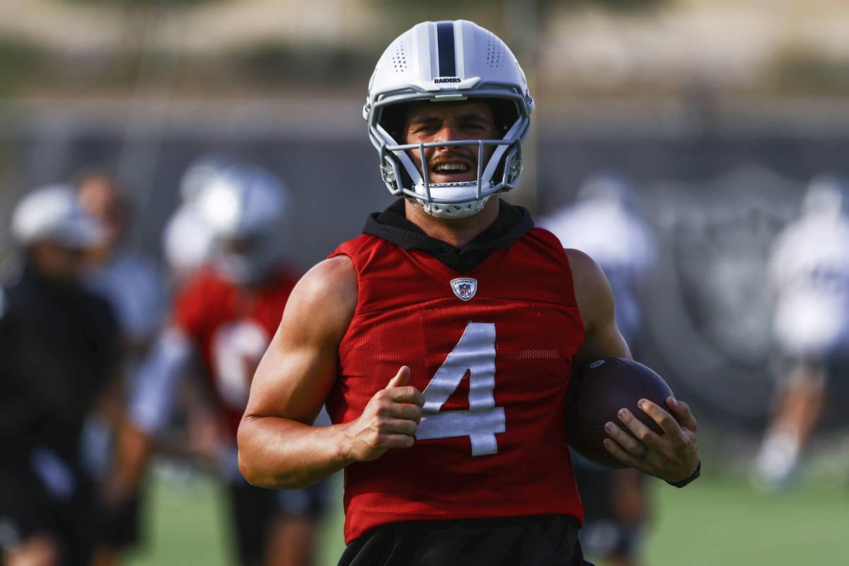 Raiders quarterback Derek Carr trains during an NFL football minicamp at Raiders headquarters i ...