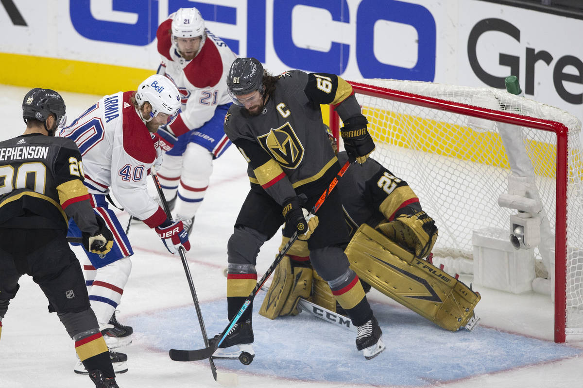 Golden Knights right wing Mark Stone (61) defends goaltender Marc-Andre Fleury (29) while Canad ...