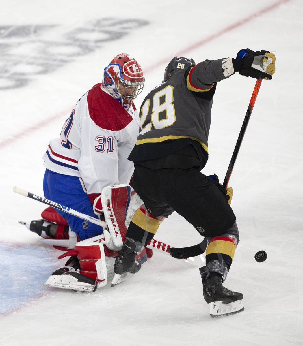 Canadiens goaltender Carey Price (31) saves a shot by Golden Knights left wing William Carrier ...