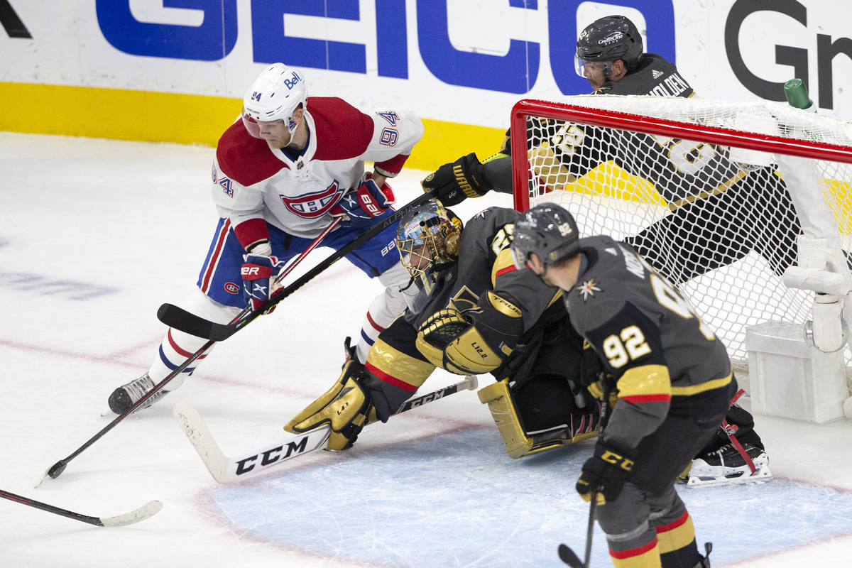 Canadiens right wing Corey Perry (94) attempts a goal while Golden Knights goaltender Marc-Andr ...
