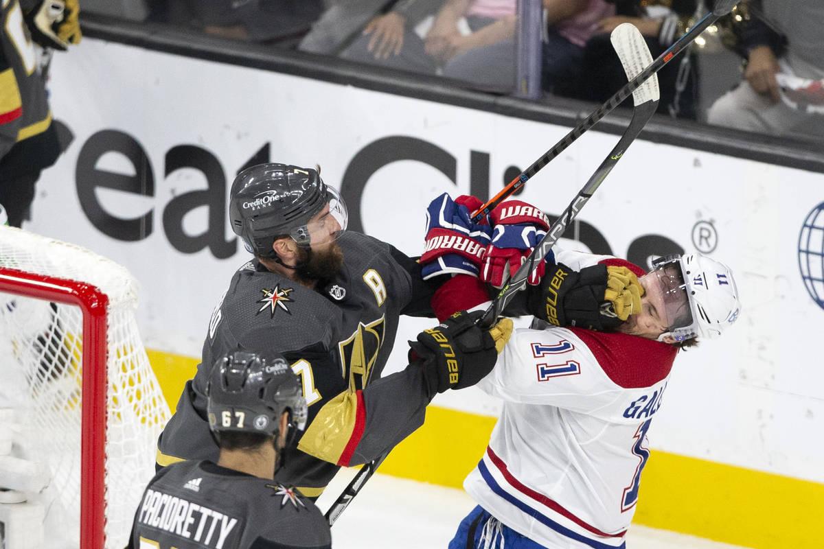 Golden Knights defenseman Alex Pietrangelo (7) punches Canadiens right wing Brendan Gallagher ( ...