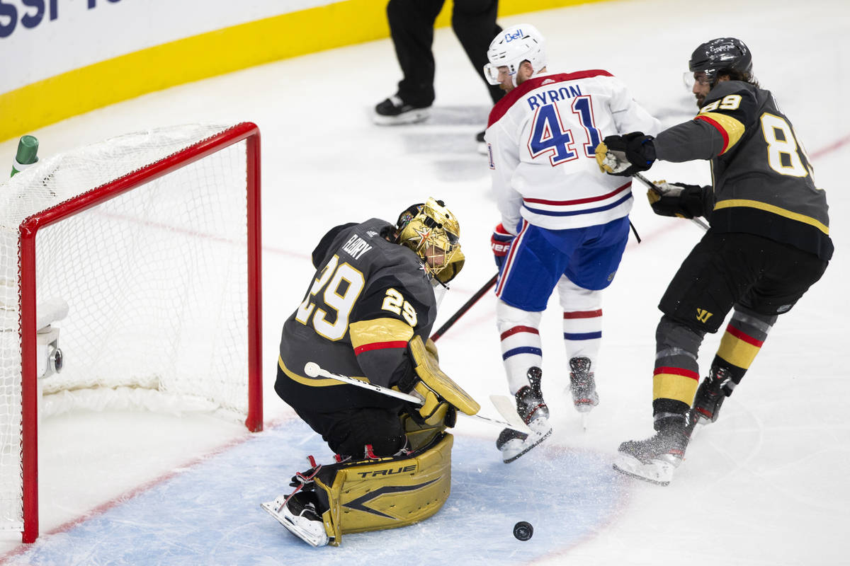 Golden Knights goaltender Marc-Andre Fleury (29) saves a shot by Canadiens right wing Paul Byro ...