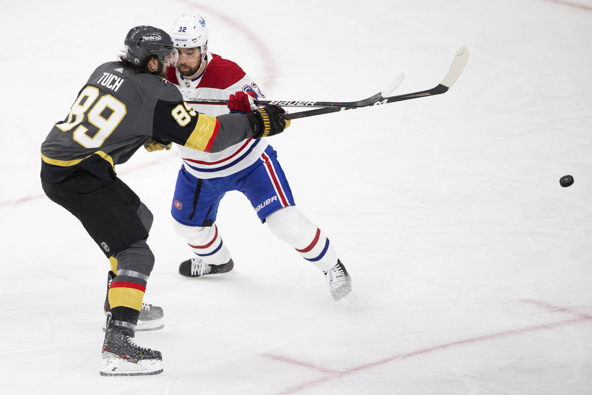 Golden Knights right wing Alex Tuch (89) takes a shot on goal while Canadiens defenseman Erik G ...