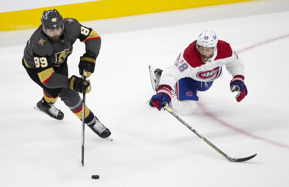 Golden Knights right wing Alex Tuch (89) and Canadiens defenseman Jon Merrill (28) skate for th ...