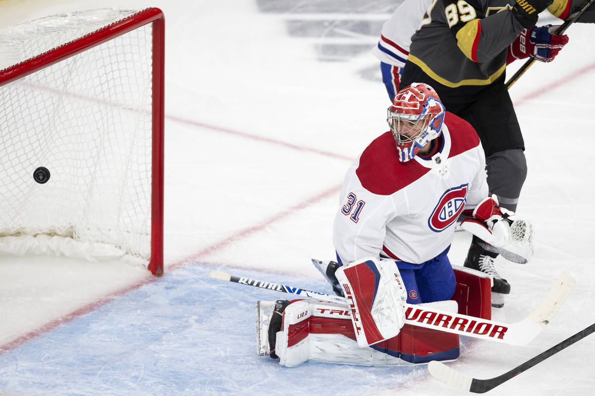 Canadiens goaltender Carey Price (31) watches Golden Knights left wing Max Pacioretty's (67) sh ...