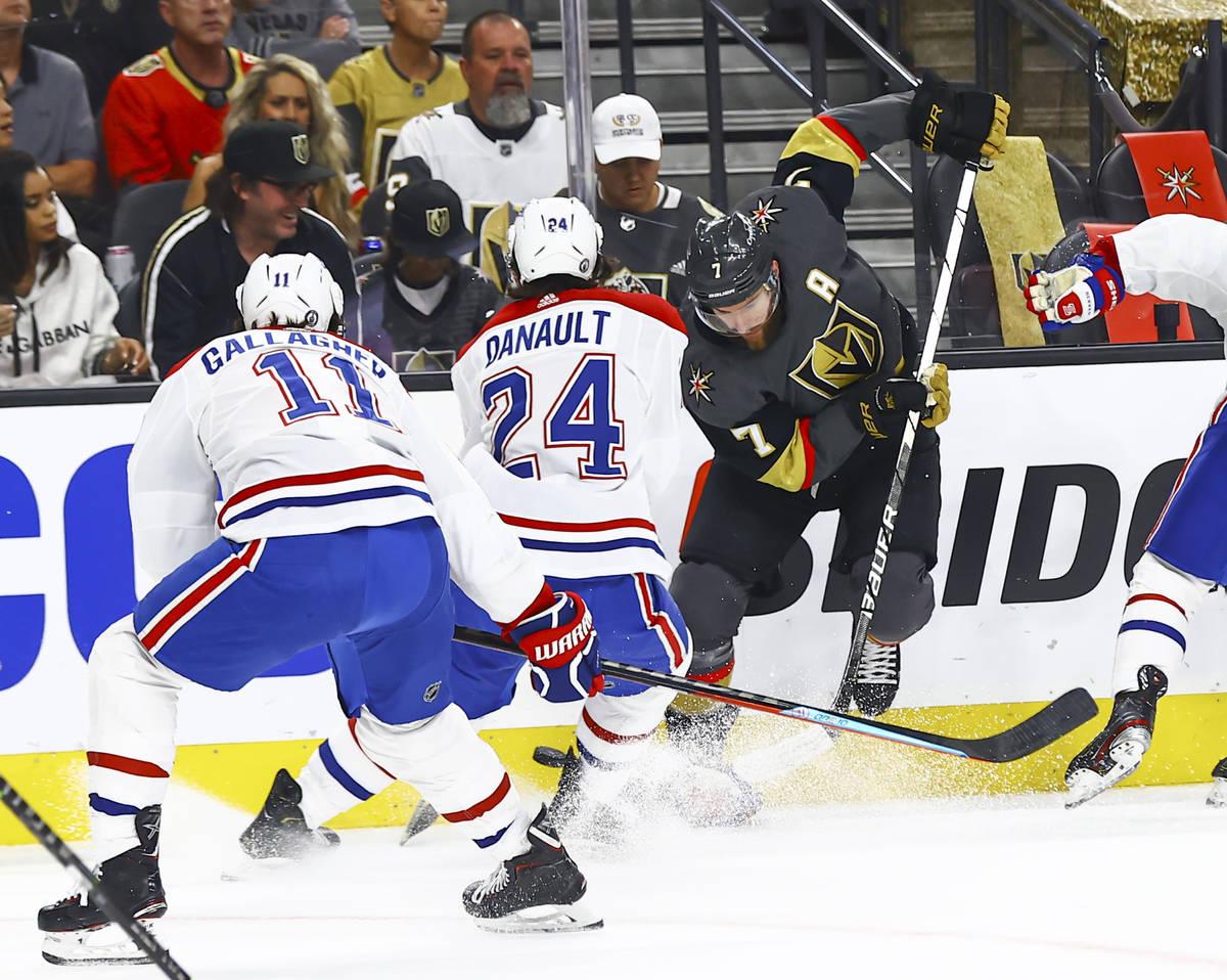 Golden Knights' Alex Pietrangelo (7) battles for the puck against Montreal Canadiens' Phillip D ...