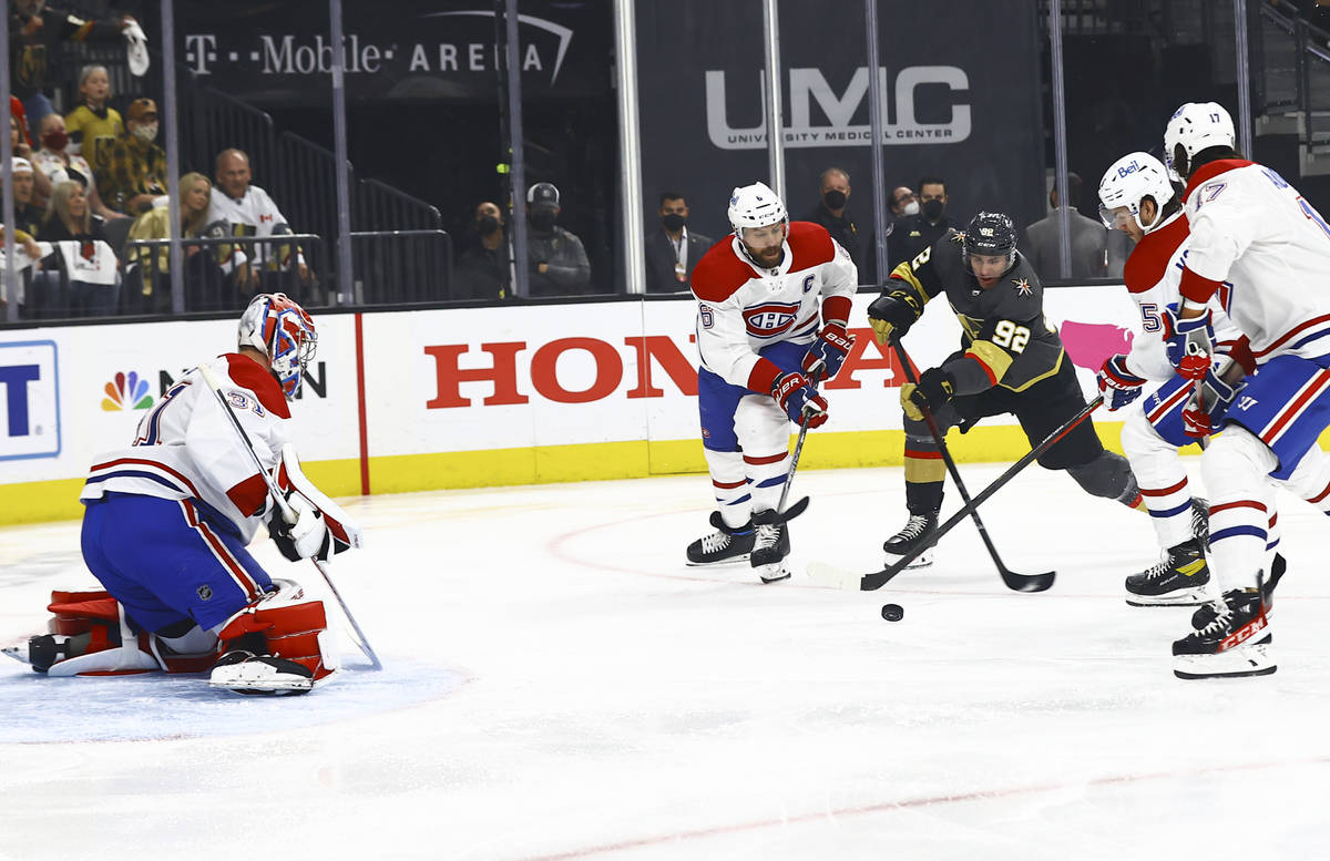 Golden KnightsÕ Tomas Nosek (92) looks to shoot under pressure from Montreal Canadiens' Sh ...