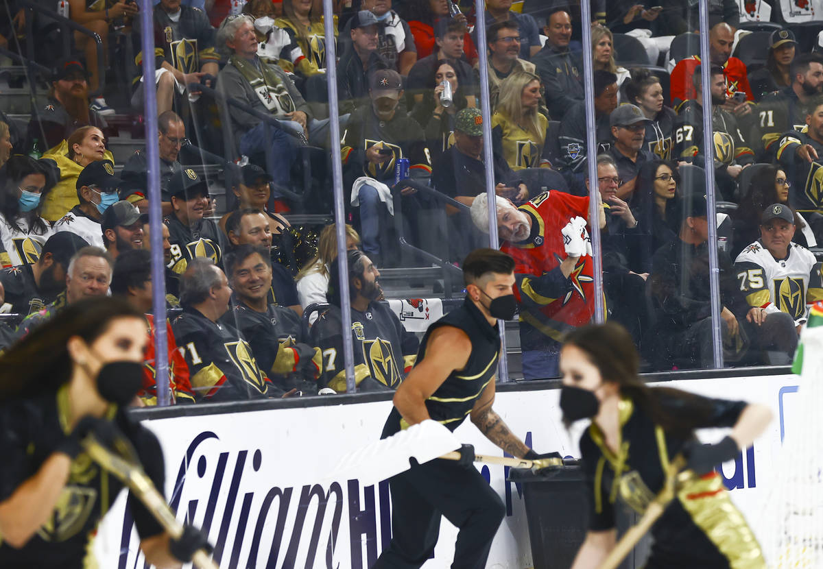 A Golden Knights fan wipes down the glass during a break in the first period of Game 5 of an NH ...