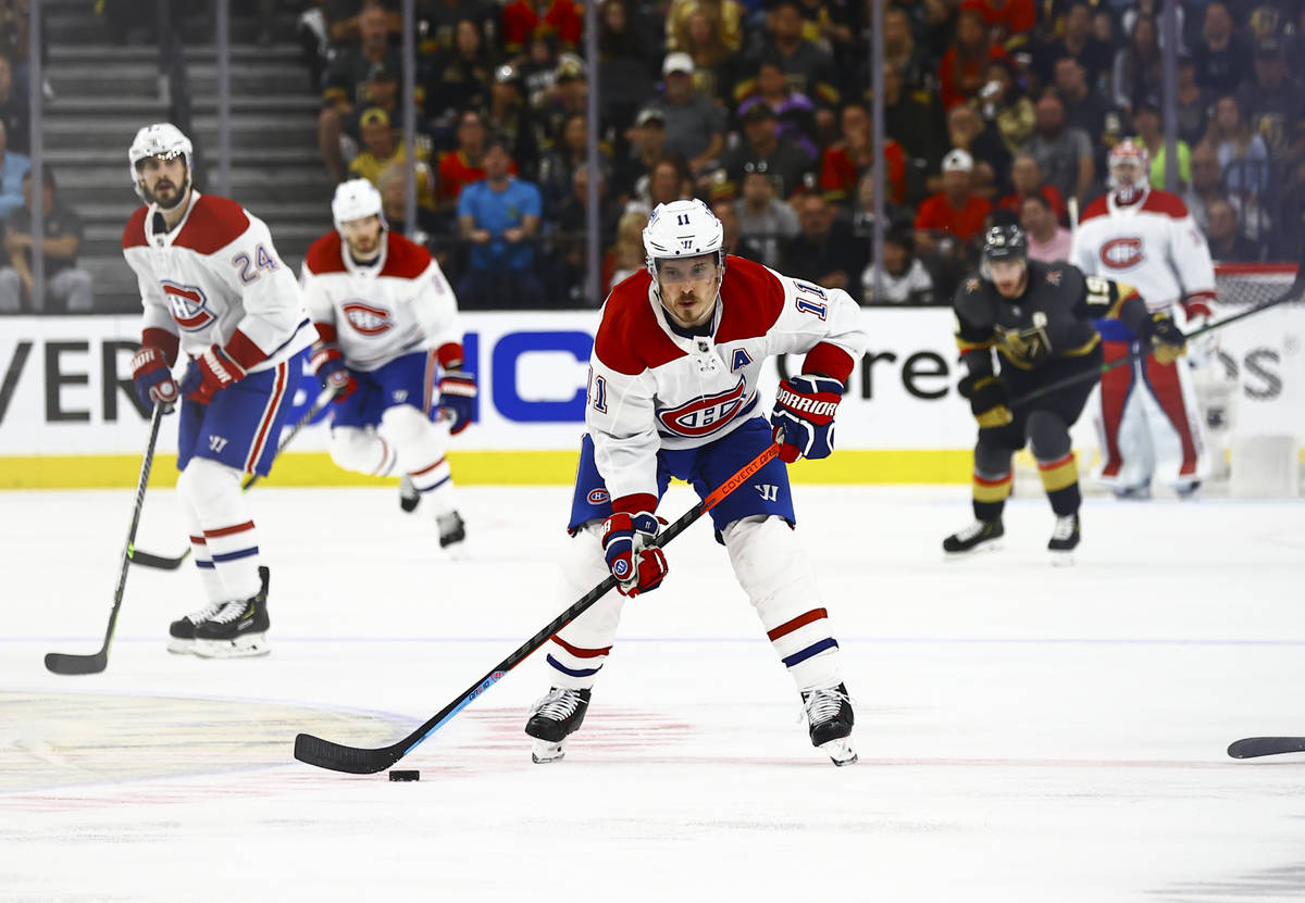 Montreal Canadiens' Brendan Gallagher (11) skates with the puck during the second period of Gam ...