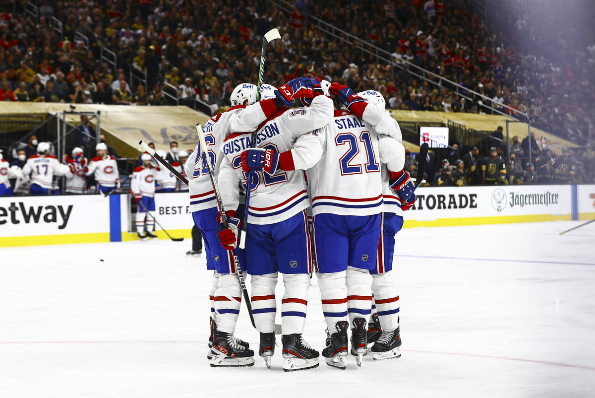 The Montreal Canadiens celebrate their first goal of the second period of Game 5 of an NHL hock ...