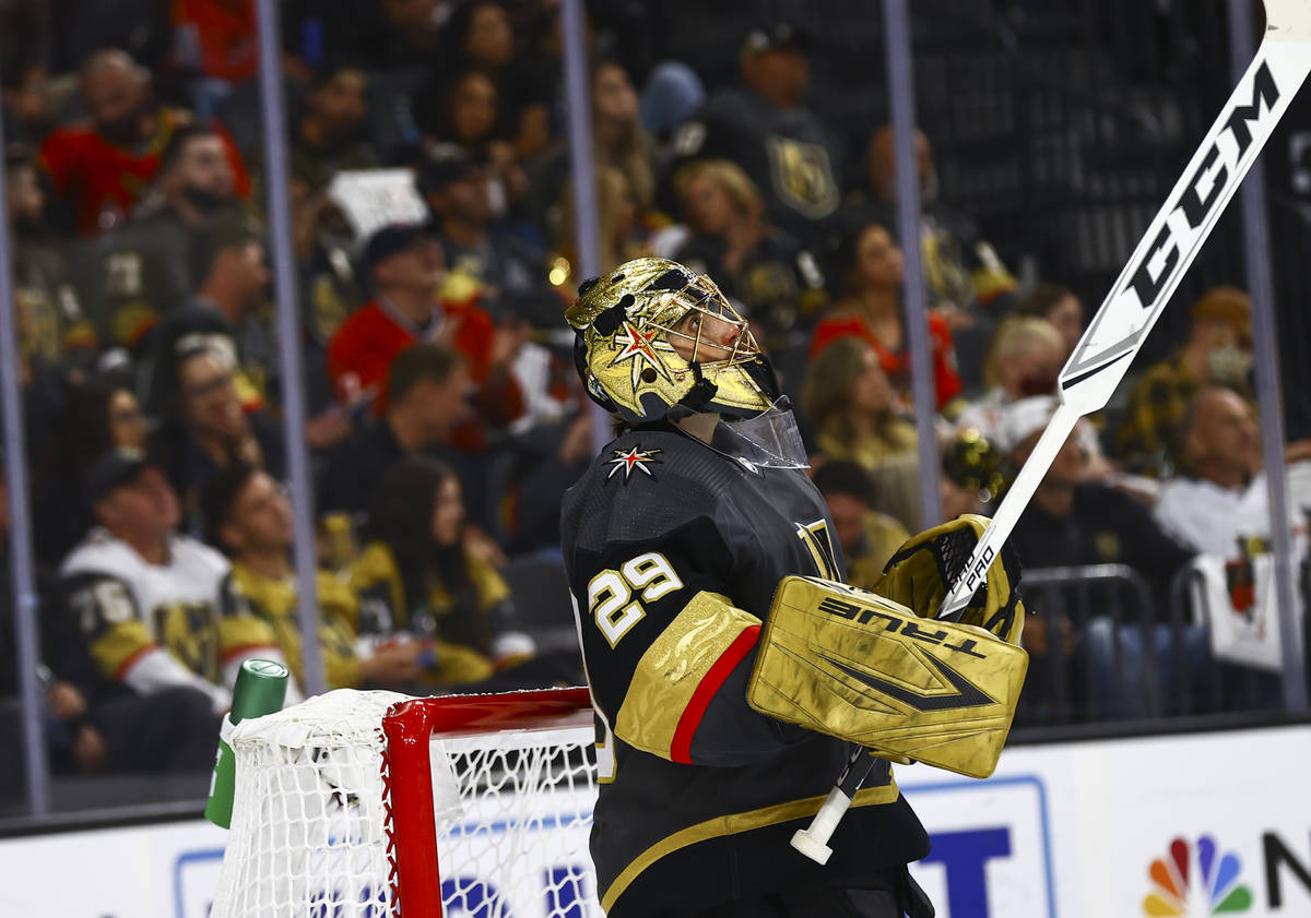 Golden Knights goaltender Marc-Andre Fleury (29) looks at the screen after giving up the first ...