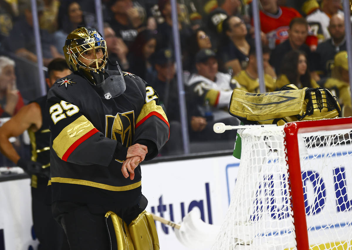 Golden Knights goaltender Marc-Andre Fleury (29) takes his gloves off during a break after givi ...