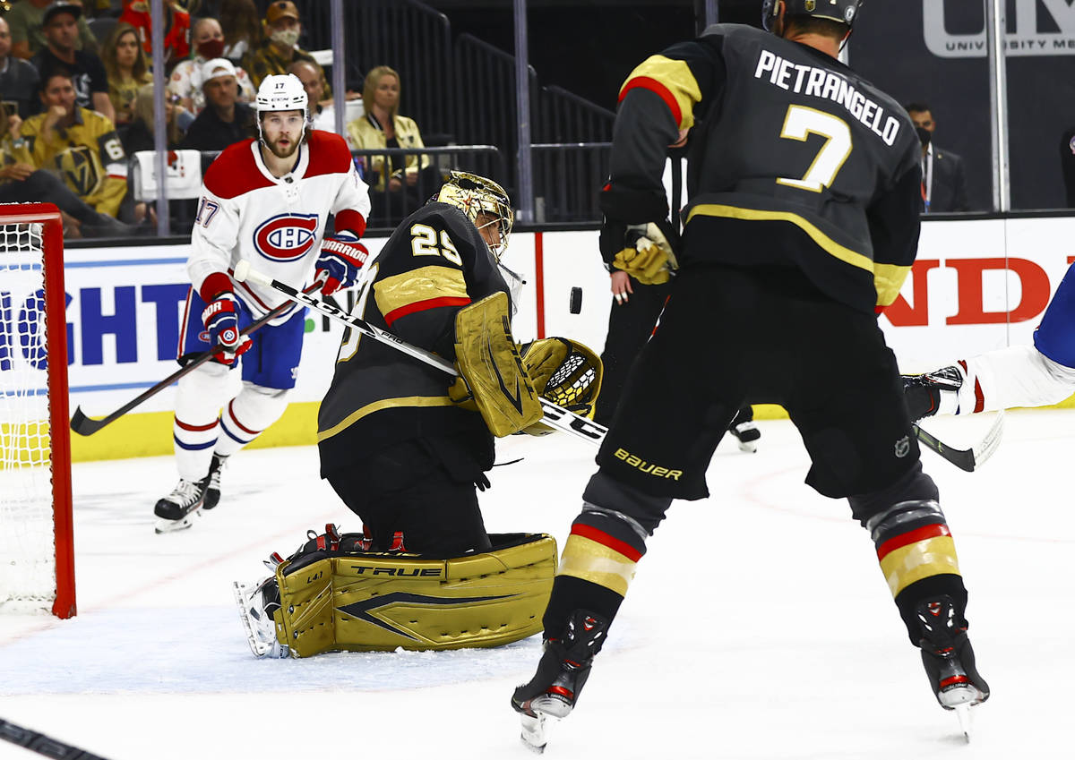 Golden Knights goaltender Marc-Andre Fleury (29) reaches out to stop the puck in front of the M ...
