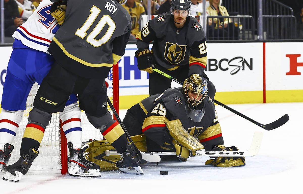 Golden Knights goaltender Marc-Andre Fleury (29) reaches out to stop the puck against the Montr ...