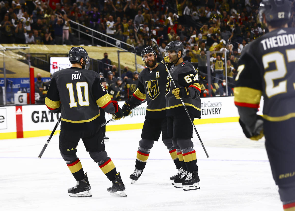 Golden Knights' Max Pacioretty (67) celebrates his goal with Nicolas Roy (10) and Alex Pietrang ...