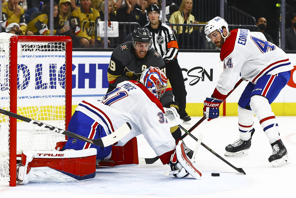 Golden Knights' Reilly Smith (19) tries to get the puck in against Montreal Canadiens' goaltend ...