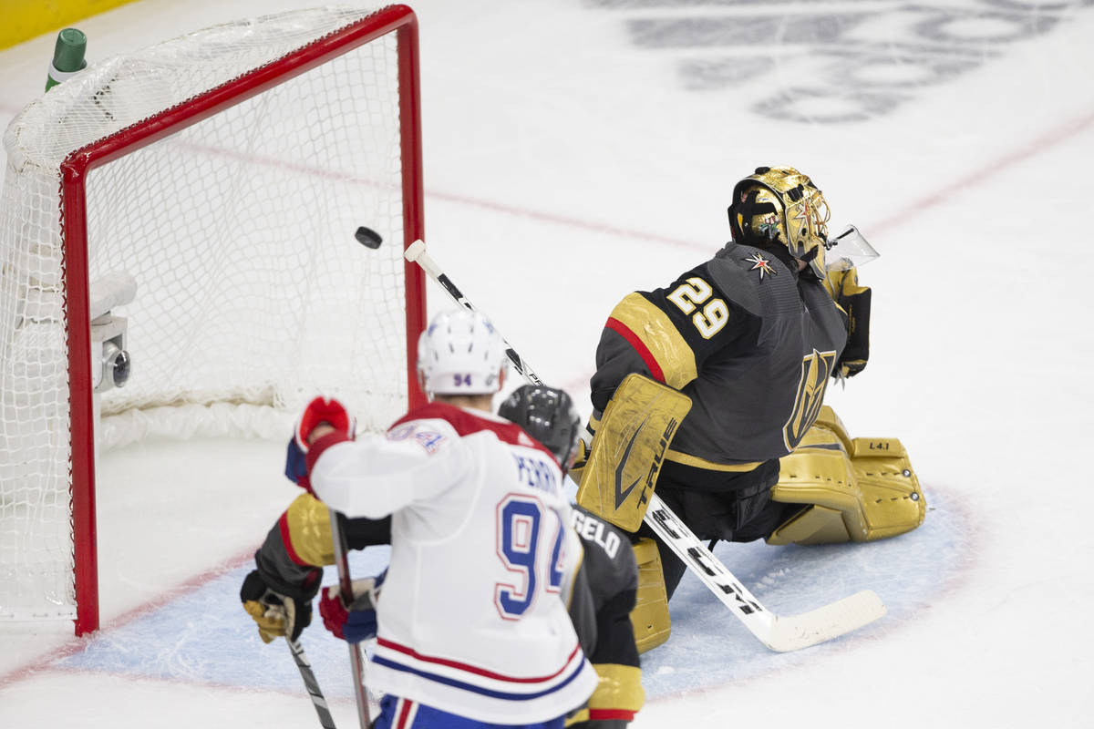 Golden Knights goaltender Marc-Andre Fleury (29) misses the save on a goal shot by Canadiens ri ...