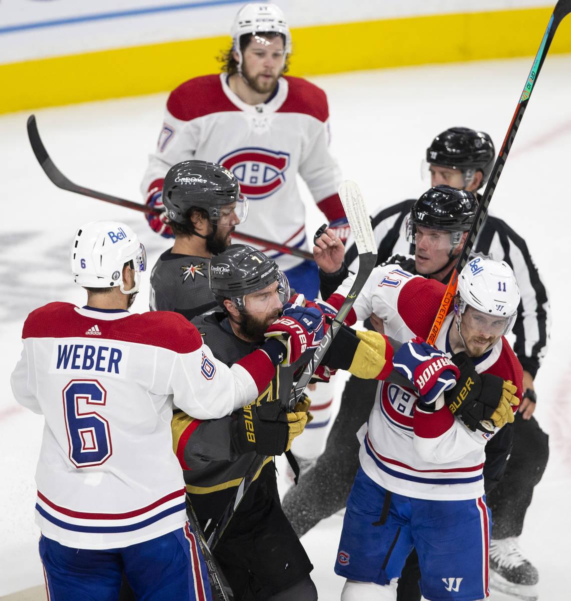 Golden Knights defenseman Alex Pietrangelo (7) and Canadiens right wing Brendan Gallagher (11) ...