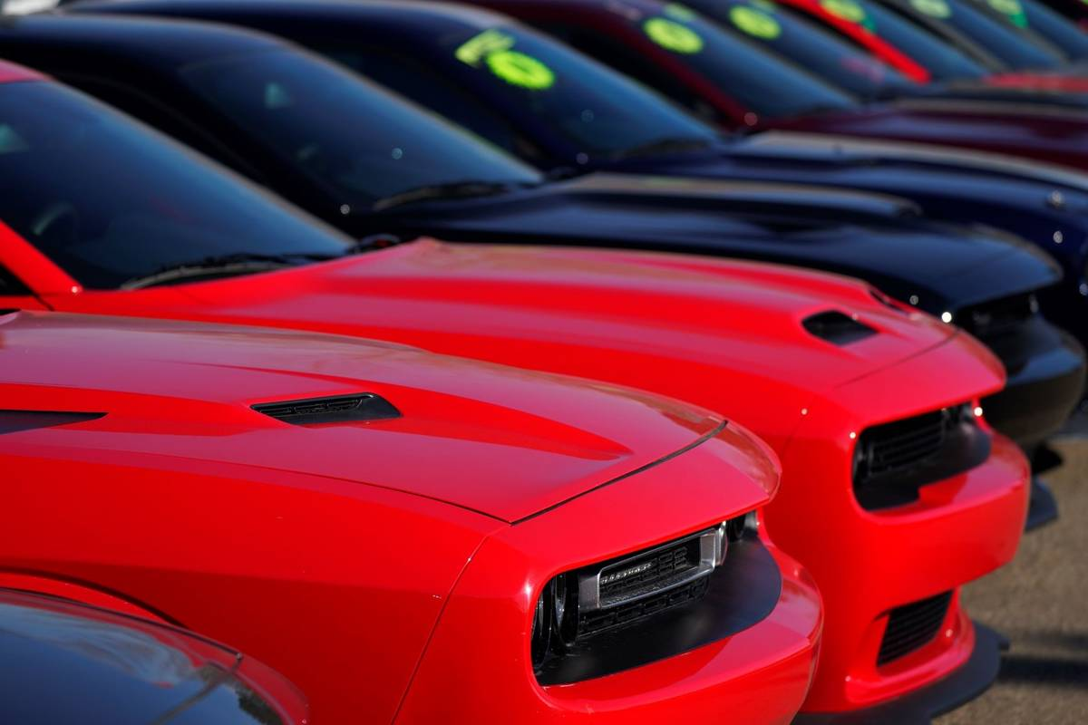 A long line of used Challengers at a Dodge dealership is seen in Littleton, Colo., in 2021. (AP ...